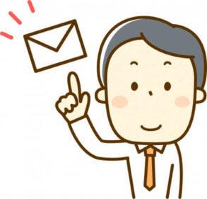 メールで挨拶をするビジネスマン